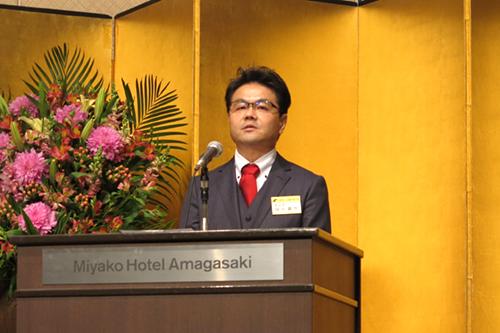 部会長に再任され、決意を語る細井氏